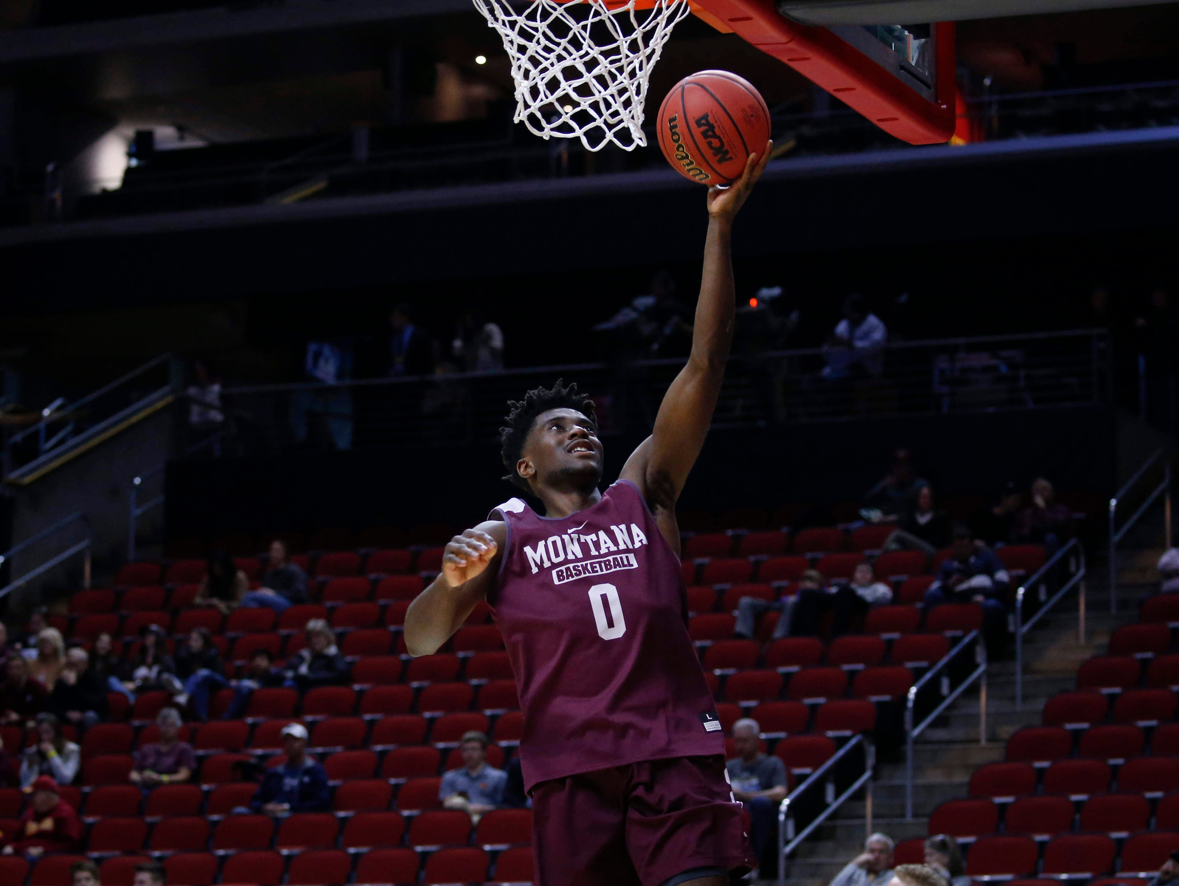 Montana senior Michael Oguine runs the ball up to the net during open practice on Wednesday, March 20, 2019, at Wells Fargo Arena in Des Moines, Iowa.
