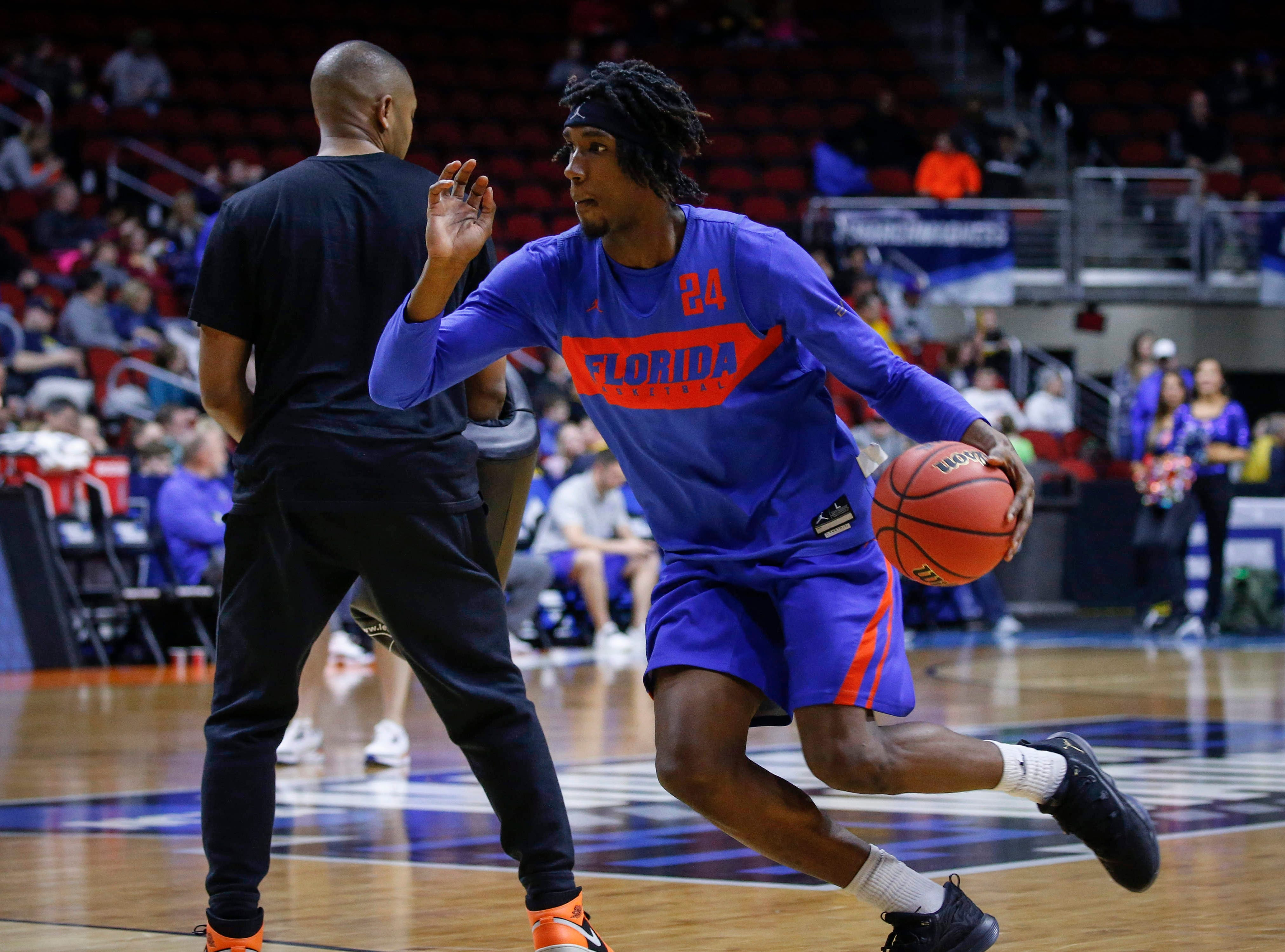 Florida sophomore guard Deaundrae Ballard drives the ball to the net during open practice on Wednesday, March 20, 2019, at Wells Fargo Arena in Des Moines, Iowa.