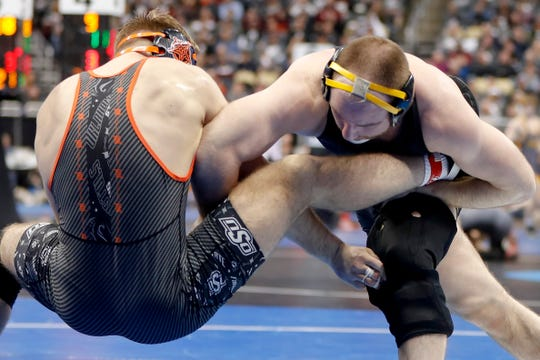 Iowa's Alex Marinelli, right, and Oklahoma State's Joseph Smith battle during their 165 lb. match in the first round of the NCAA wrestling championship, Thursday, March 21, 2019, in Pittsburgh.