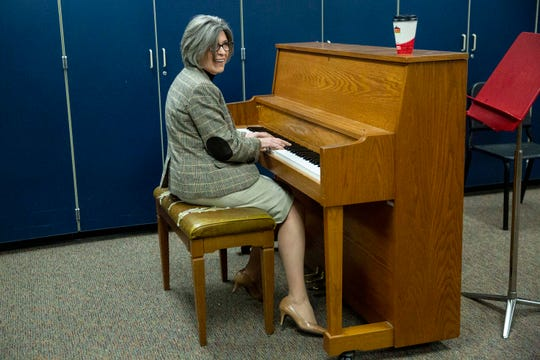 U.S. Sen. Joni Ernst, R-Red Oak, takes a seat at the piano in the Adel DeSoto Minburn High School choir room between her town hall meeting and talking with reporters on Thursday, March 21, 2019, in Adel.