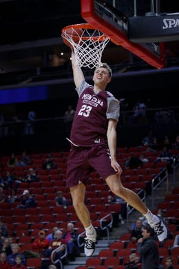 bf72d6360571fa Montana freshman Mack Anderson dunks the ball during open practice on  Wednesday