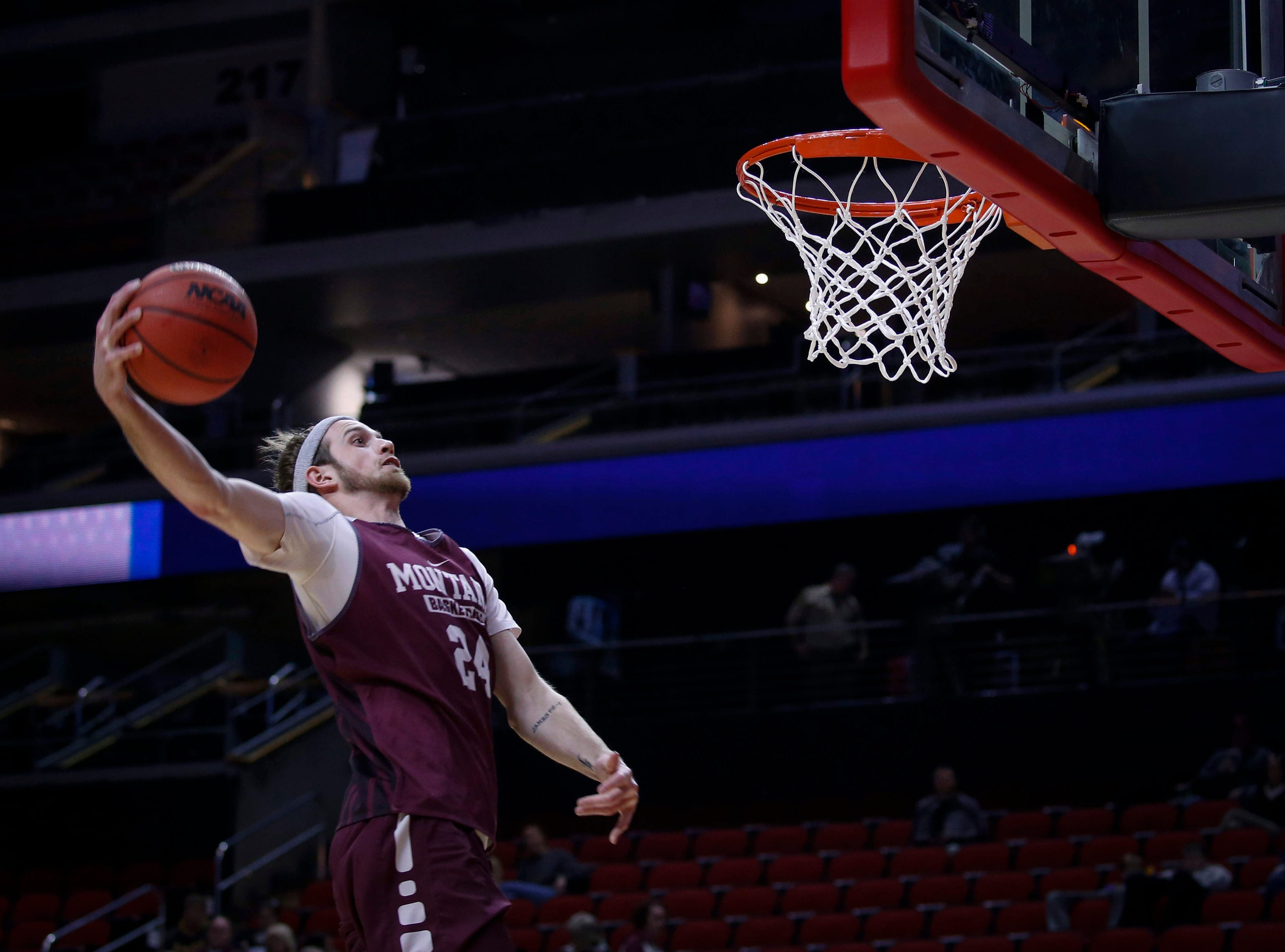 Montana senior Bobby Moorehead dunks the ball during open practice on Wednesday, March 20, 2019, at Wells Fargo Arena in Des Moines, Iowa.