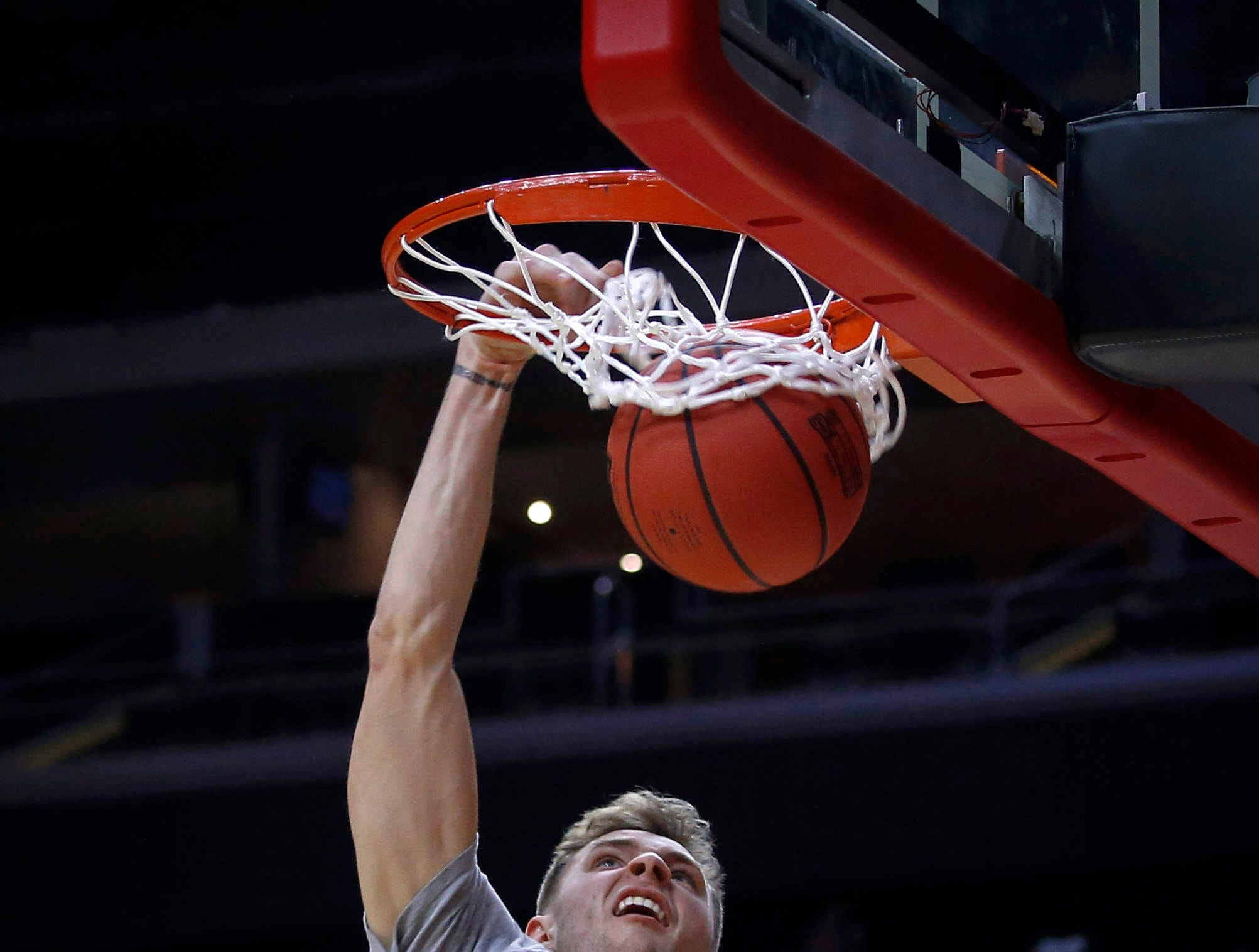 Montana freshman Mack Anderson dunks the ball during open practice on Wednesday, March 20, 2019, at Wells Fargo Arena in Des Moines, Iowa.