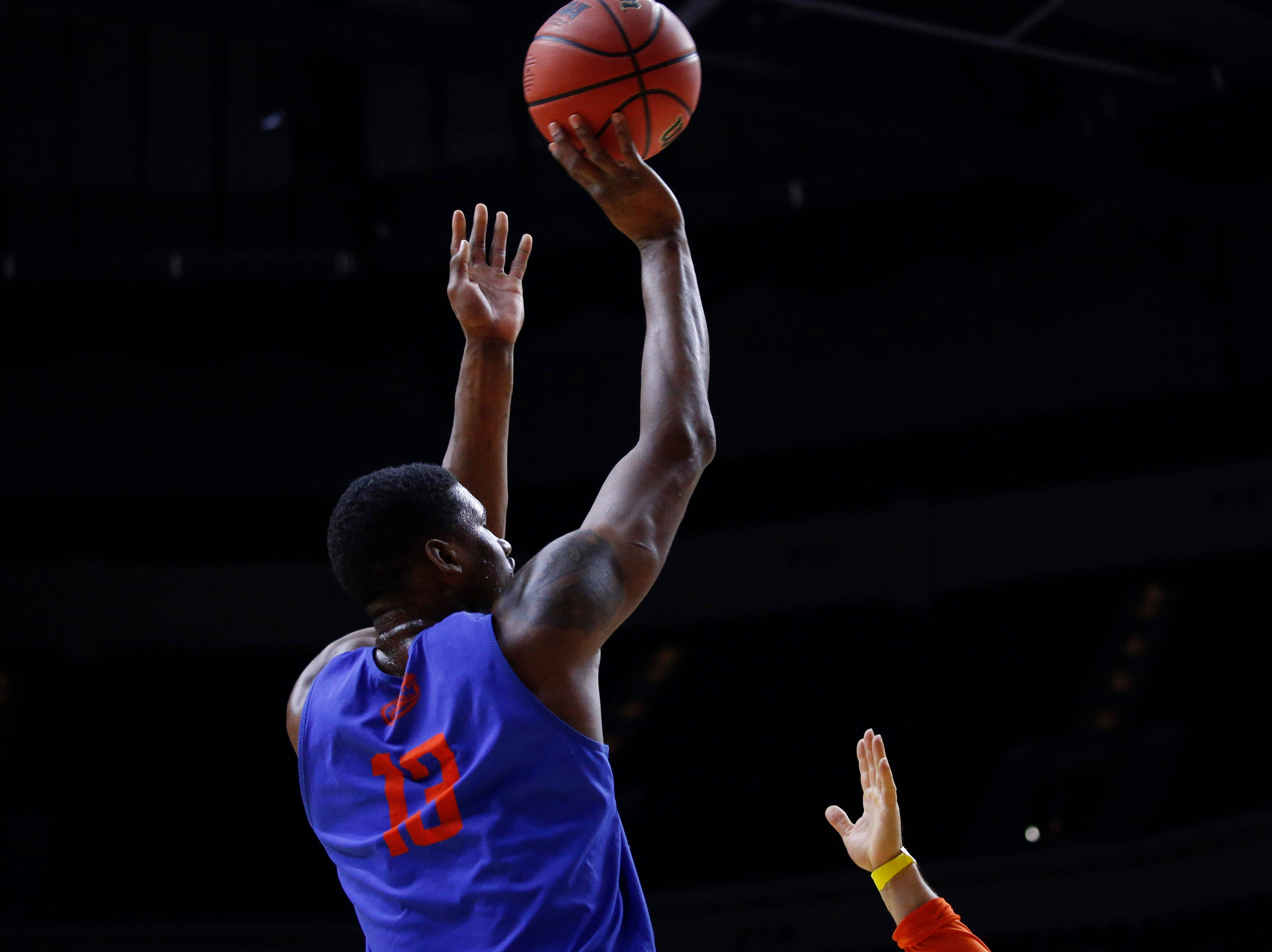 Florida senior Kevarrius Hayes shoots the ball during open practice on Wednesday, March 20, 2019, at Wells Fargo Arena in Des Moines, Iowa.