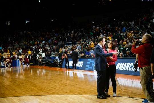 Valley grad Dana Jacobson interviews Minnesota head coach Richard Pitino during their NCAA Division I Men's Basketball Championship First Round game on Thursday, March 21, 2019, in Des Moines. Minnesota takes a 38-33 lead into halftime.