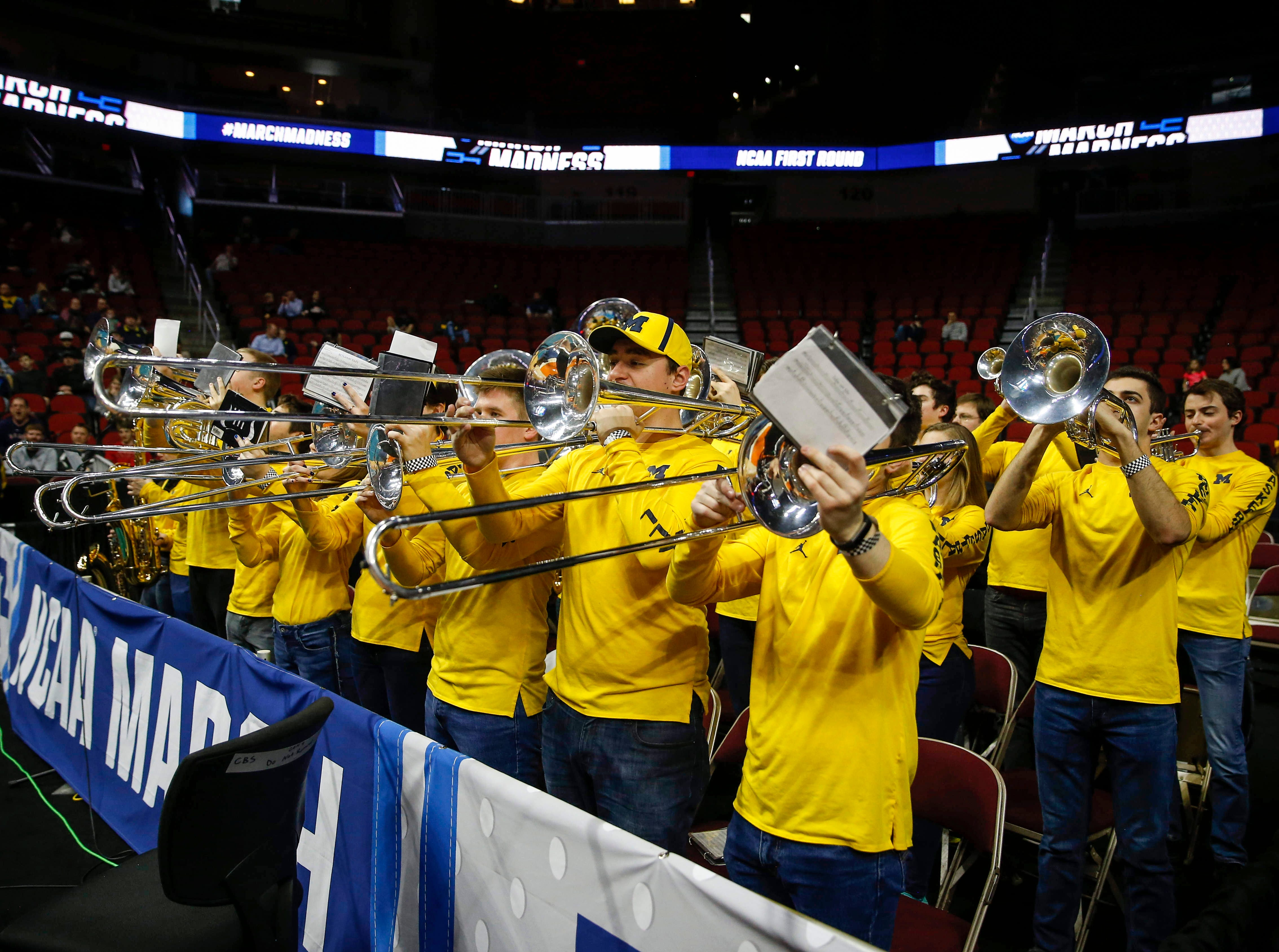 Members of the Michigan band play as the men's basketball team takes the court for open practice on Wednesday, March 20, 2019, at Wells Fargo Arena in Des Moines, Iowa.