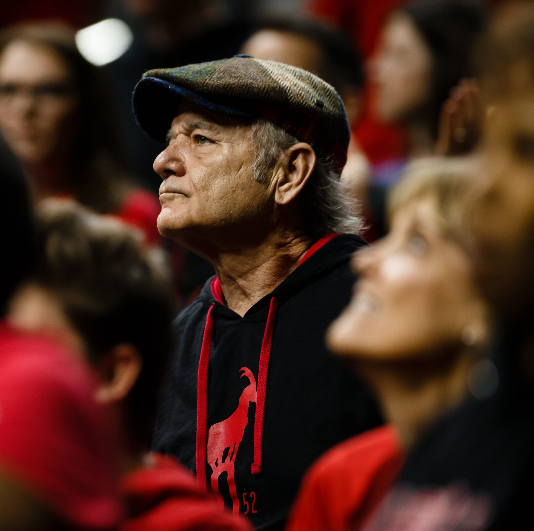 Bill Murray basks in honorable defeat with Louisville staff and fans before leaving Des Moines