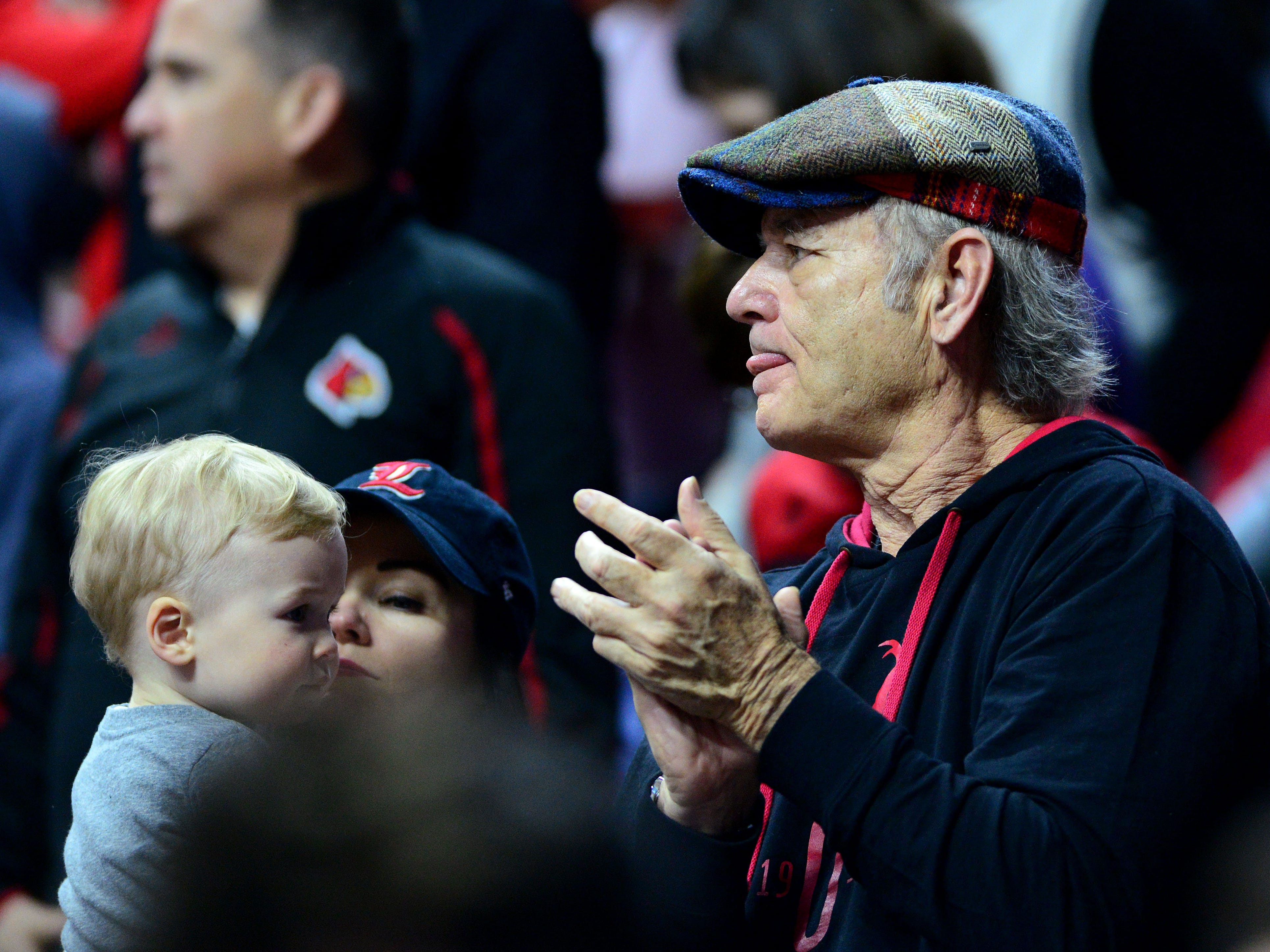 Actor Bill Murray watches the game between the Minnesota Golden Gophers and the Louisville Cardinals in the first round of the 2019 NCAA Tournament at Wells Fargo Arena. Murray's son, Luke, is an assistant coach for Louisville.