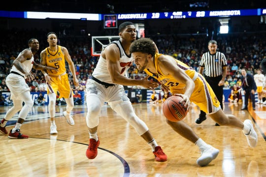 Minnesota's Gabe Kalscheur (22) drives to the net during their NCAA Division I Men's Basketball Championship First Round game on Thursday, March 21, 2019, in Des Moines. Minnesota takes a 38-33 lead into halftime.