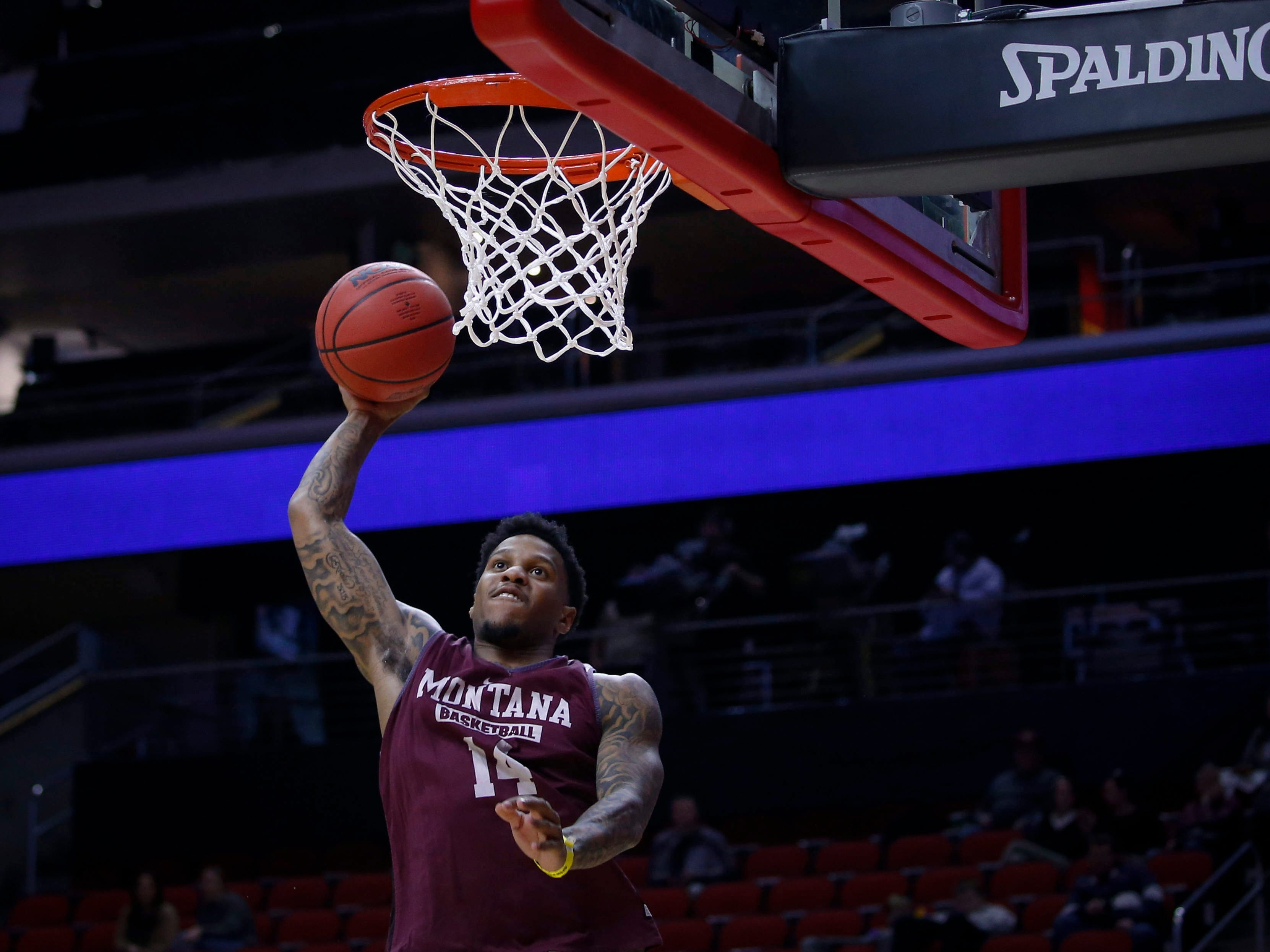Montana senior Ahmaad Rorie dunks the ball during open practice on Wednesday, March 20, 2019, at Wells Fargo Arena in Des Moines, Iowa.