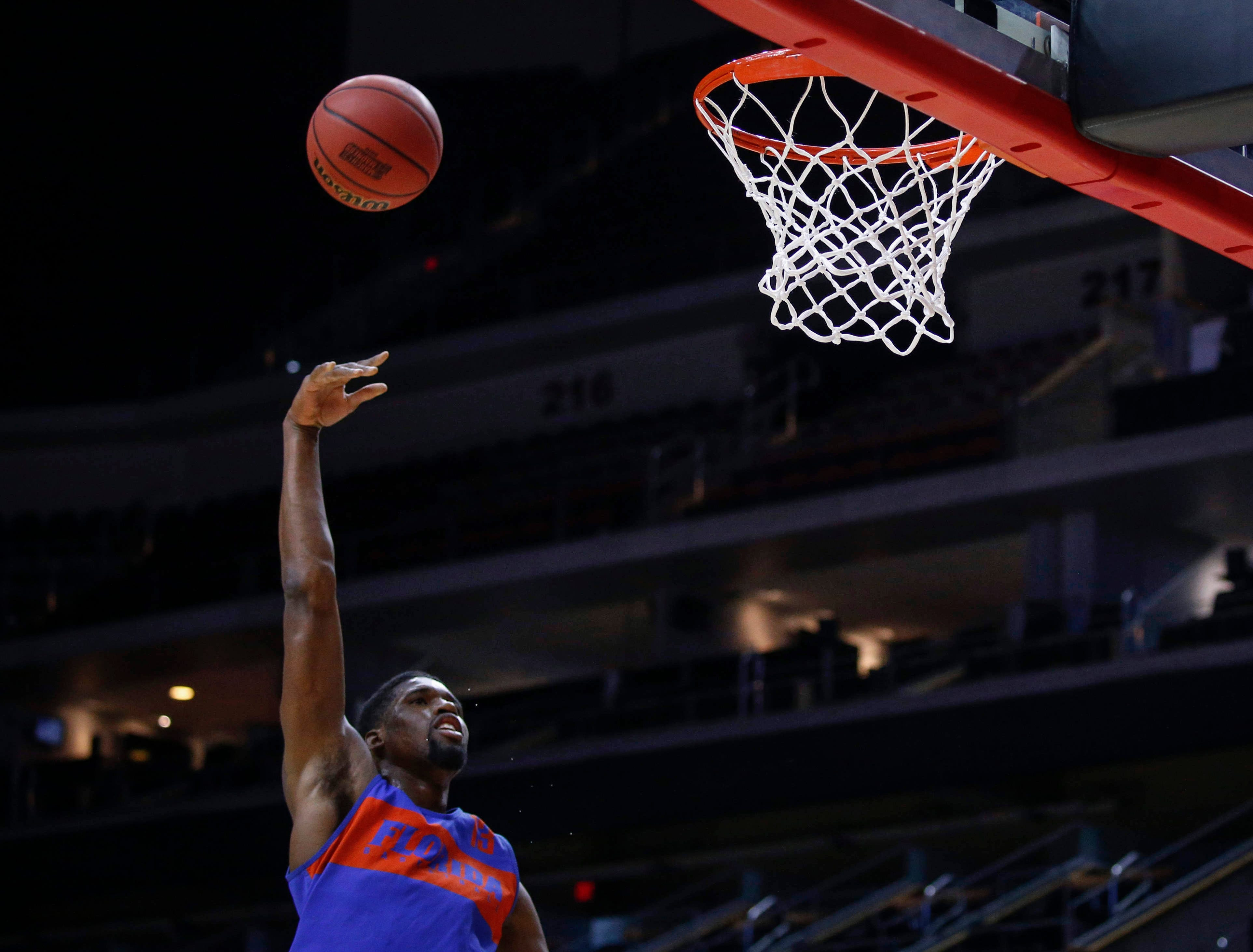 Florida senior Kevarrius Hayes hooks the ball into the basket during open practice on Wednesday, March 20, 2019, at Wells Fargo Arena in Des Moines, Iowa.