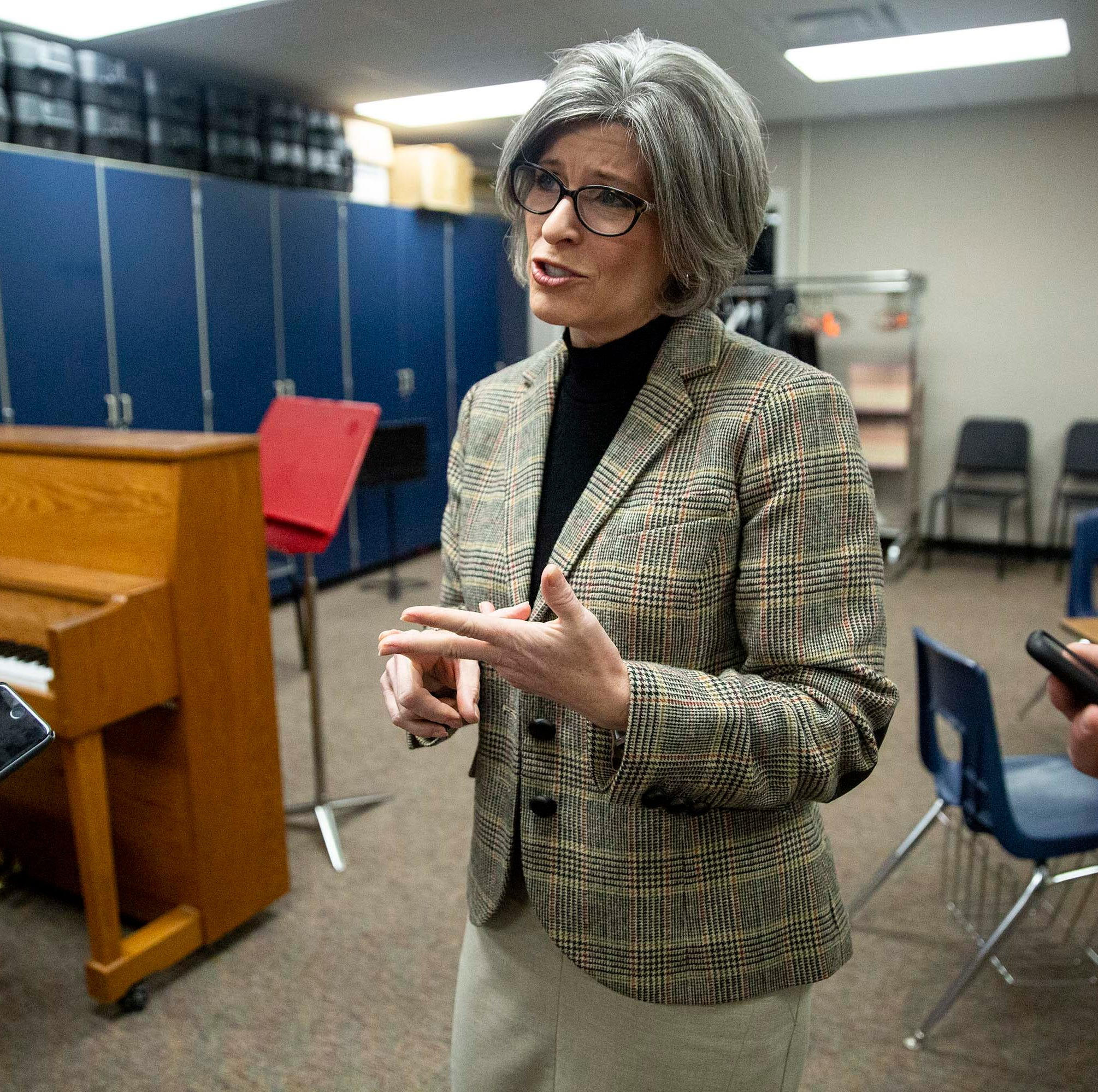 U.S. Sen. Joni Ernst, R-Red Oak, talks to reporters after holding a town hall meeting on Thursday, March 21, 2019, in the Adel DeSoto Minburn High School Auditorium in Adel.