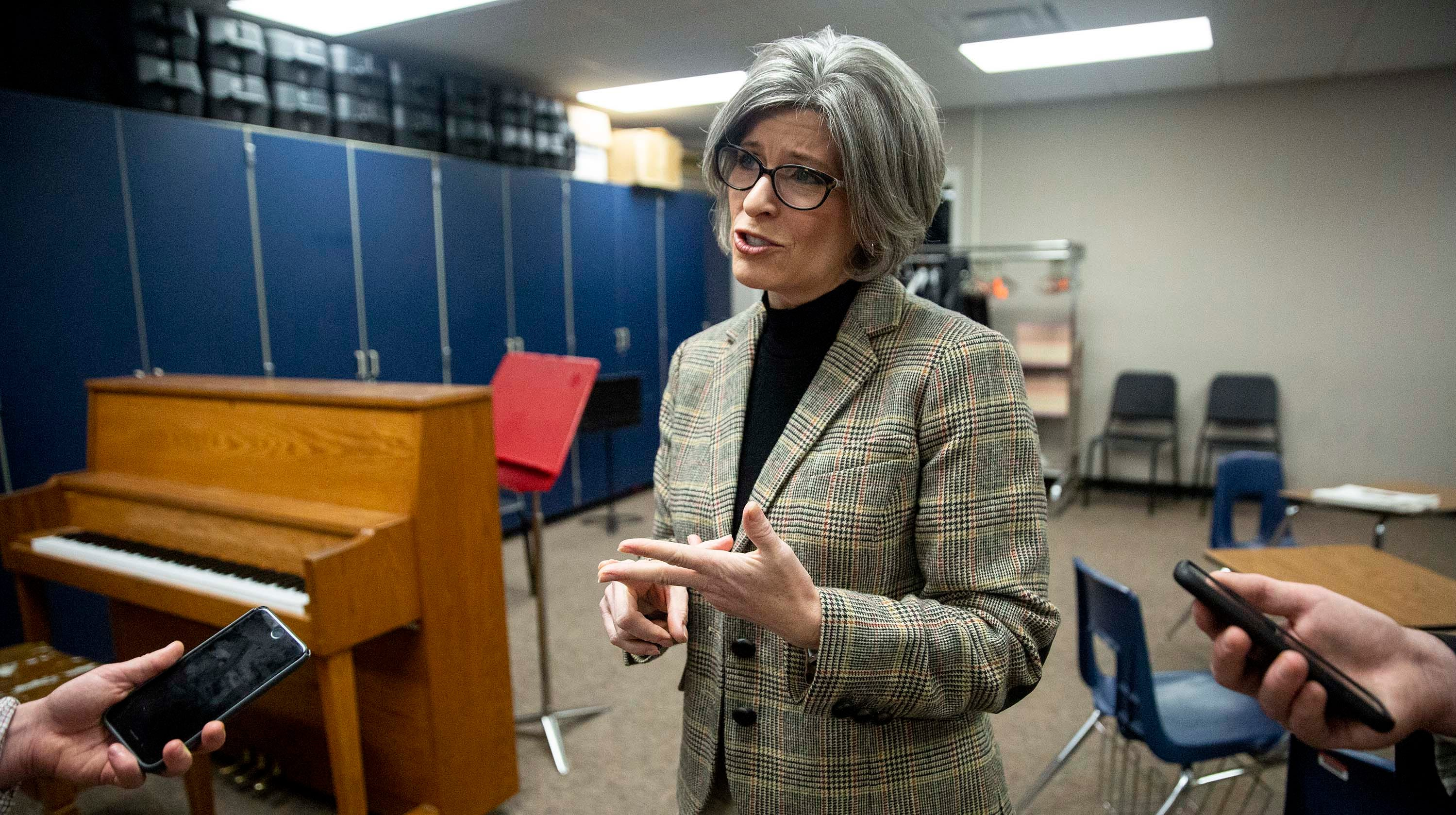 U.S. Sen. Joni Ernst, R-Red Oak, talks to reporters after holding a town hall meeting on Thursday, March 21, 2018, in the Adel DeSoto Minburn High School Auditorium in Adel.