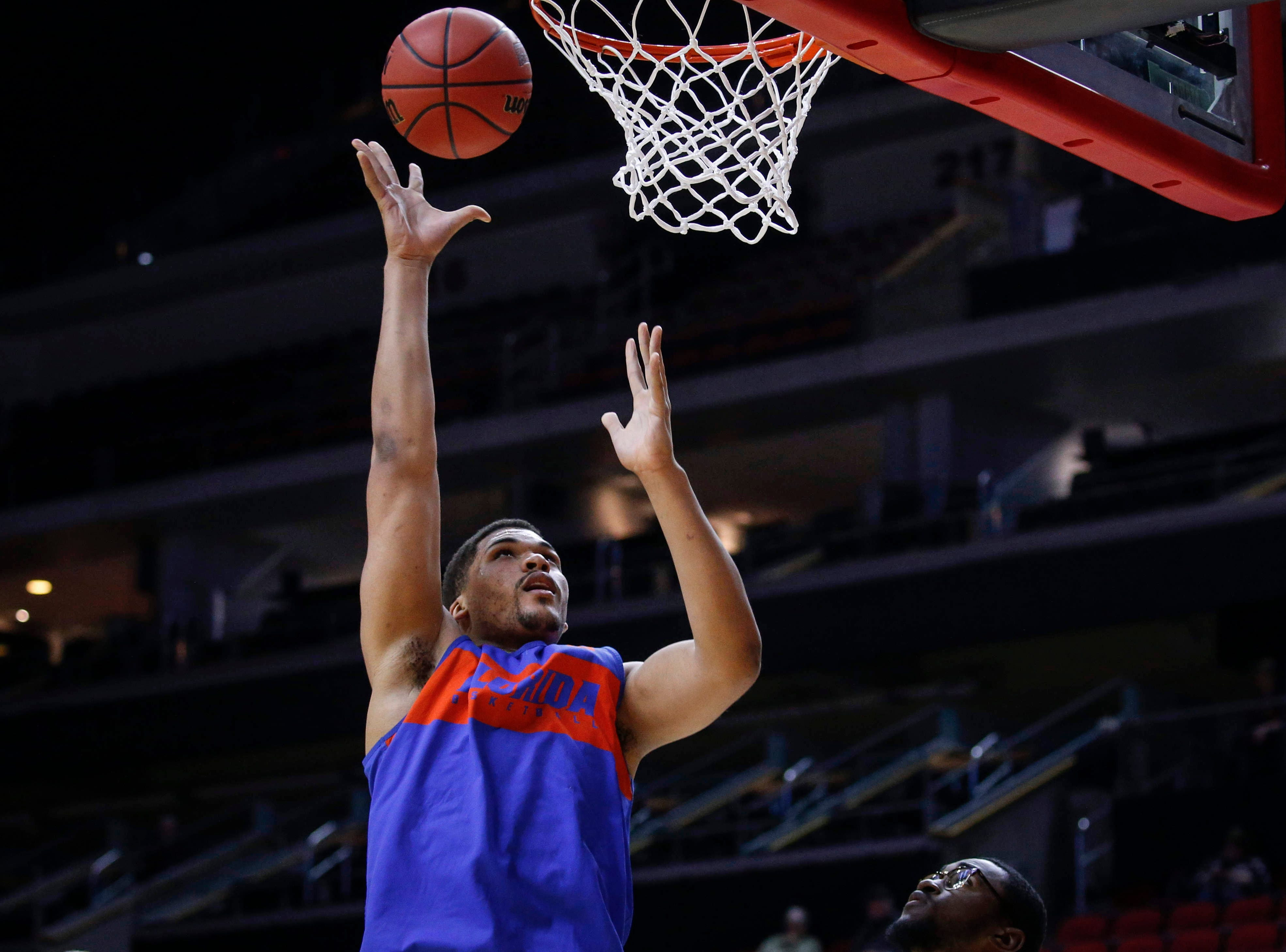 Florida freshman Isaiah Stokes puts the ball in the net during open practice on Wednesday, March 20, 2019, at Wells Fargo Arena in Des Moines, Iowa.