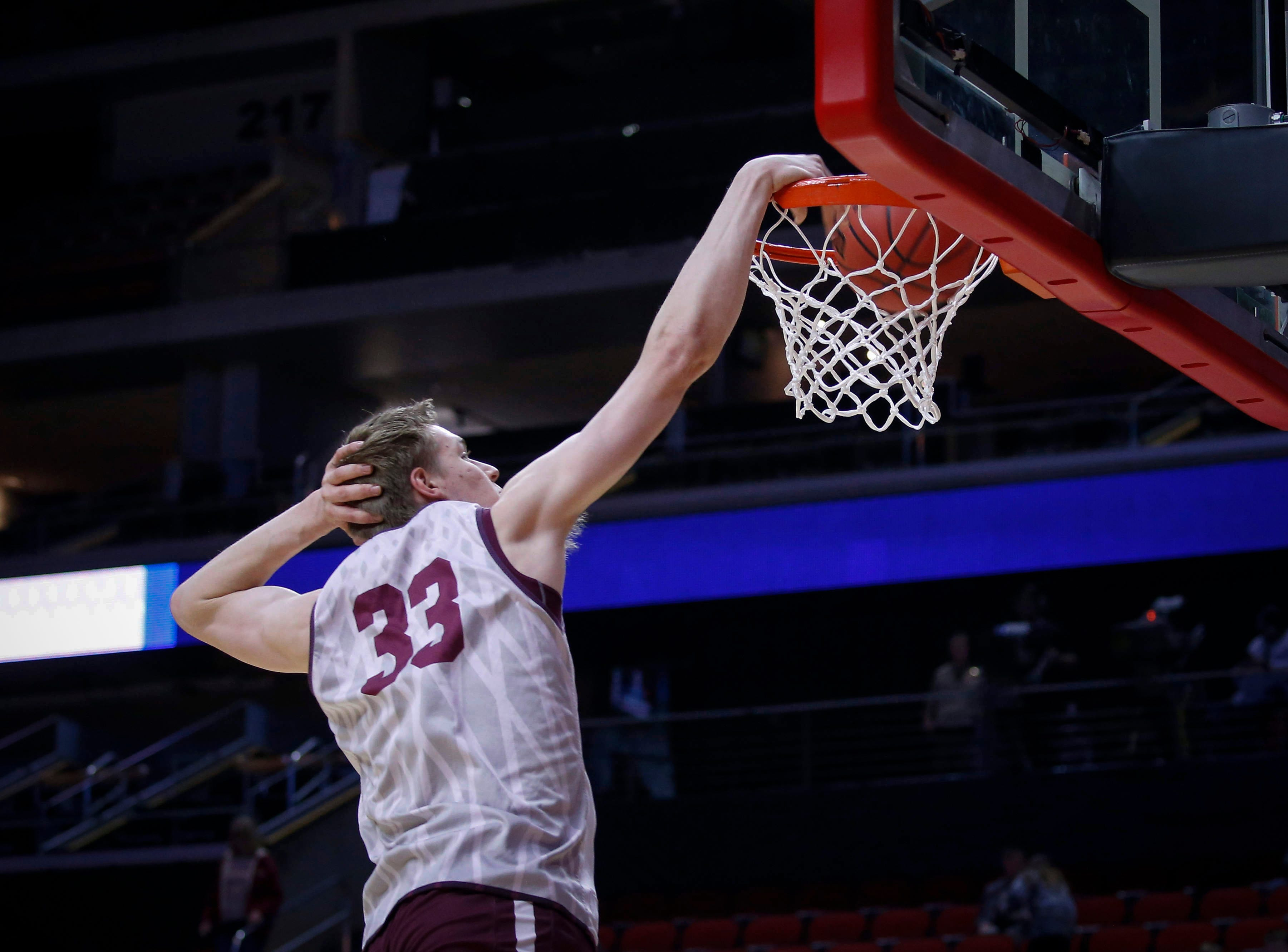 Montana freshman Kelby Kramer dabs as he dunks the ball during open practice on Wednesday, March 20, 2019, at Wells Fargo Arena in Des Moines, Iowa.