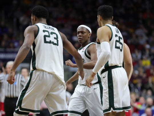 Cassius Winston walks to the bench with teammates during the second half against Bradley in the NCAA tournament Thursday.