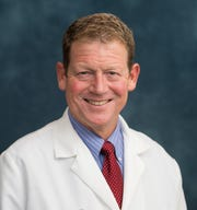 Dr. Andrew Urquhart of the University of Michigan's health system is OK with hip replacement patients maintaining active lifestyles.