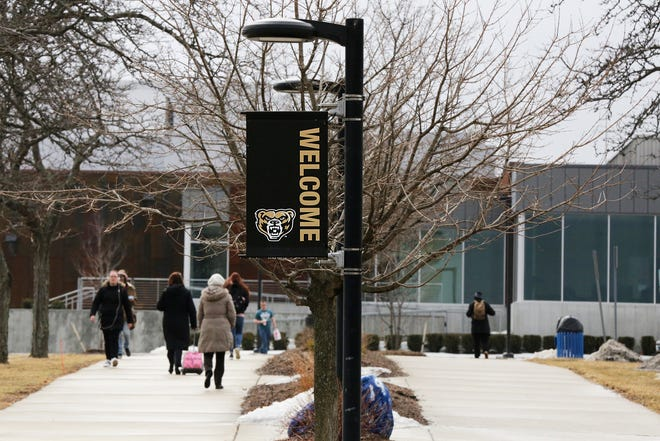 Students walk on campus toward the Oakland Center at Oakland University in Rochester on Wednesday, March 13, 2019.