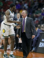 Michigan State coach Tom Izzo talks to Aaron Henry during action against Bradley in the NCAA tournament Thursday, March 21, 2019 at Wells Fargo Arena in Des Moines, Iowa.
