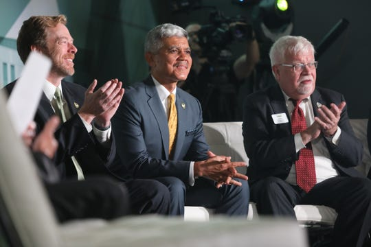 From left, WSU Board of Governors David A. Nicholson, Wayne State University President M. Roy Wilson and Robert Forsythe, dean of WSU Mike Ilitch School of Business, attend the ribbon cutting ceremony of the opening of the new Mike Ilitch School of Business at Wayne State University's downtown campus in Detroit on Tuesday, Aug. 21, 2018.