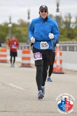 Joe Virag ran the Detroit Free Press/Chemical Bank Marathon Relay with two fake hips, Detroit, MI, October 2018