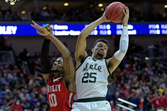 Michigan State forward Kenny Goins and Bradley forward Elijah Childs go for a rebound during the first half in the first round of the 2019 NCAA tournament at Wells Fargo Arena.