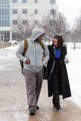New Grand Valley State University President Philomena Mantella talks with a student while walking on campus. Mantella is slated to start as Grand Valley's president this summer.