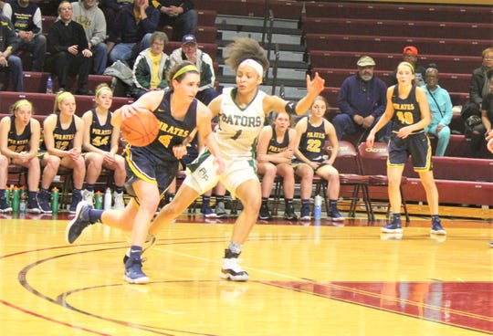 Pewamo-Westphalia's Rachel Huhn attempts to drive around Ypsilanti Arbor Prep's Mya Petticord in Friday's Division 3 semifinal. Huhn and her teammates won, 37-33 in overtime, to advance to Saturday's championship against Flint Hamady.
