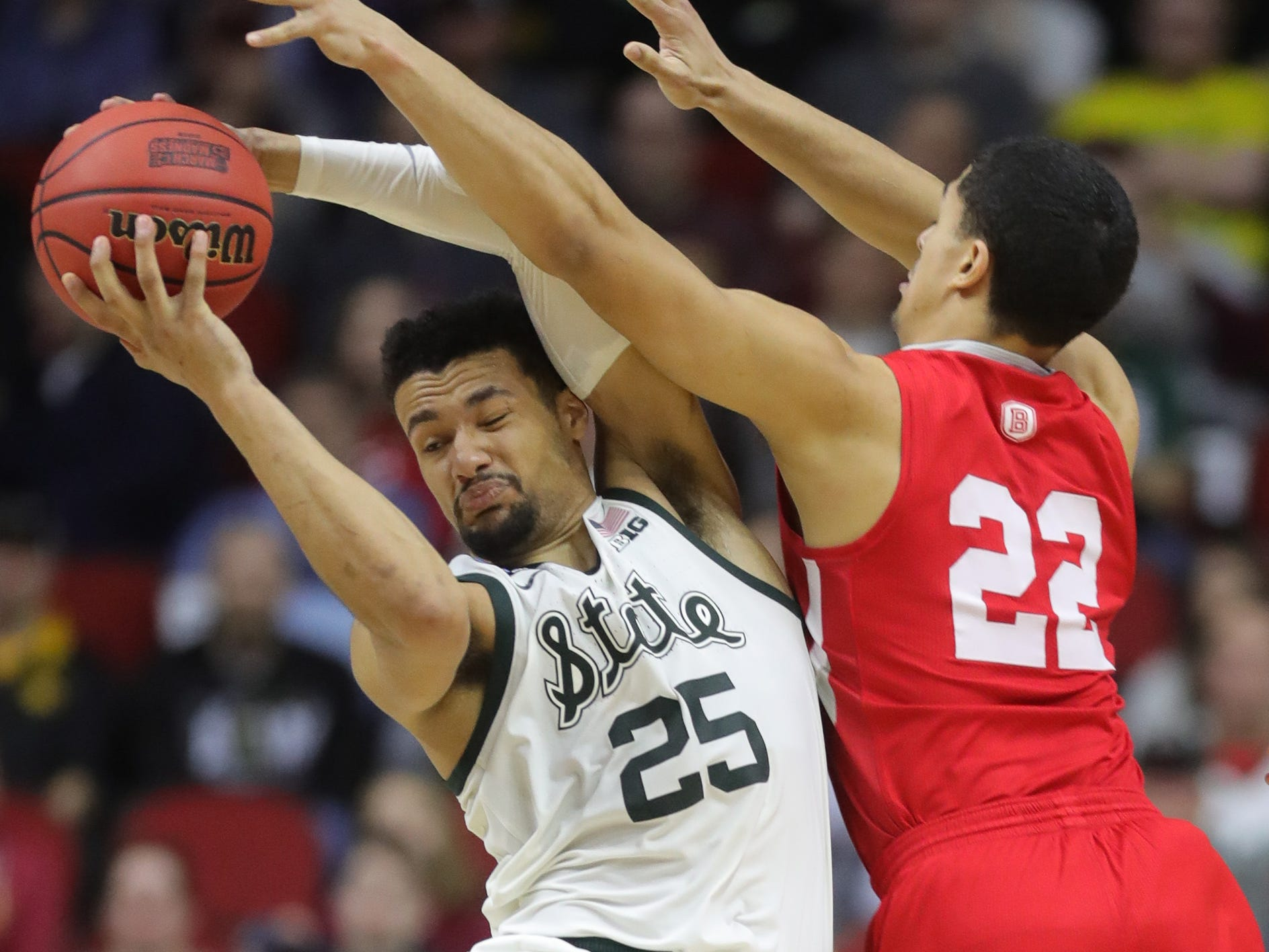 Michigan State's Kenny Goins rebounds against Bradley's Dwayne Lautier-Ogunleye during the second half of the NCAA tournament Thursday, March 21, 2019 at Wells Fargo Arena in Des Moines, Iowa.