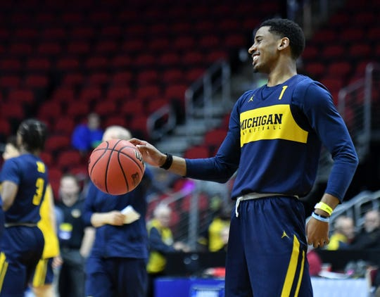 Michigan guard Charles Matthews smiles during open practice Wednesday.