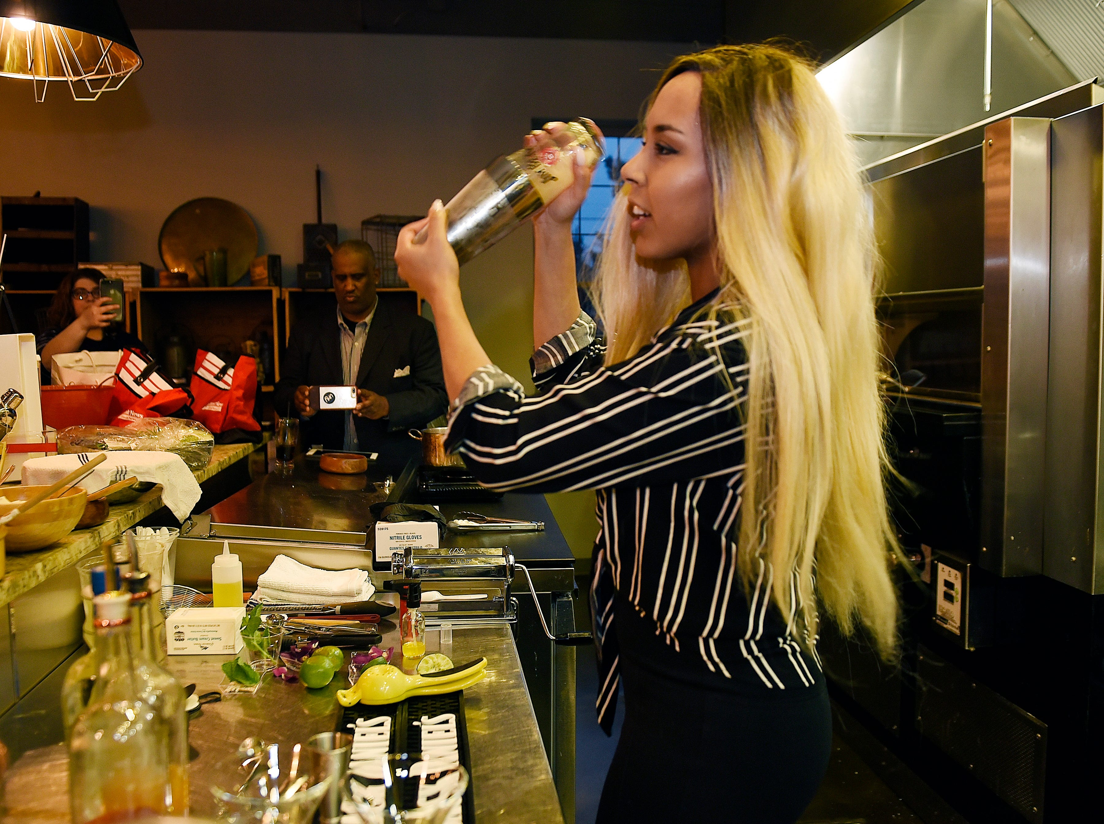 """Kay Mohamed a resident bartender in metro Detroit, she is seen making a """" Ron Con Baya"""" cocktail."""
