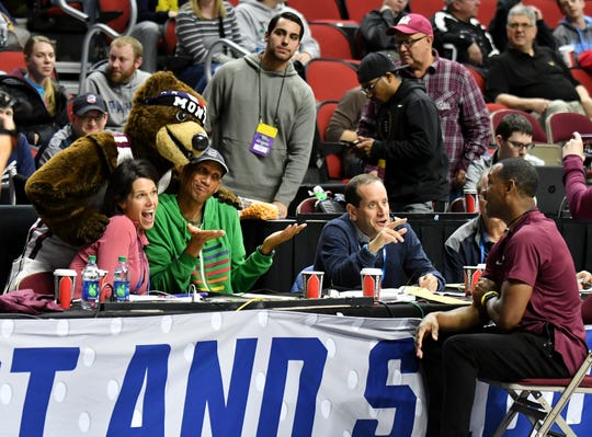 TNT broadcast crew Reggie Miller and Dana Jacobson, left, are joined briefly by Monte, the Montana mascot.