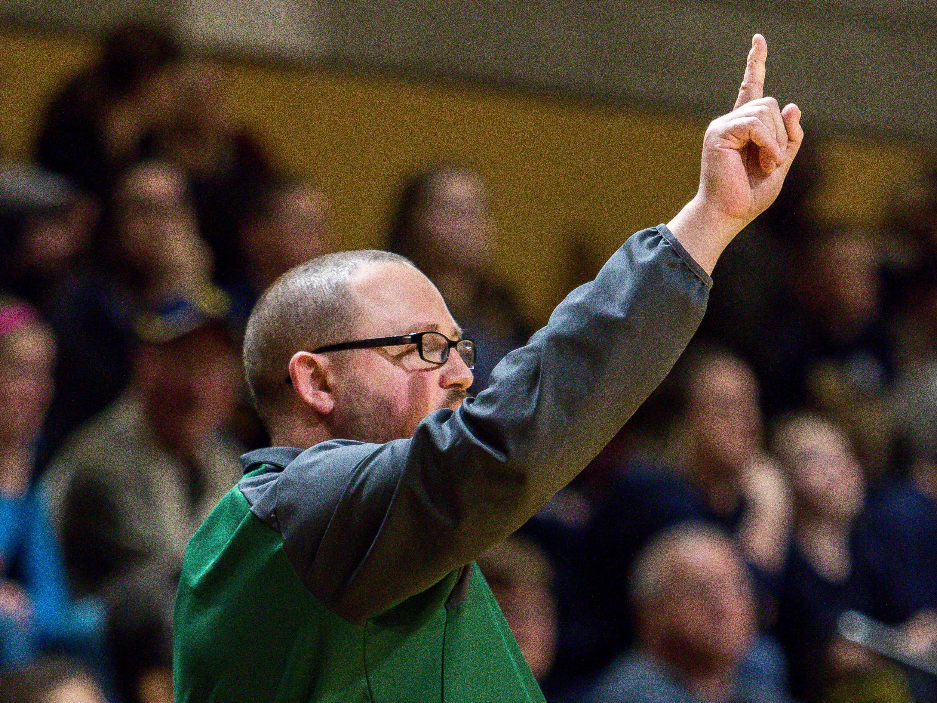 Ypsilanti Arbor Prep Head Coach Scott Stine calls a play in the first half against Pewamo-Westphalia.