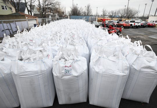 To stabilize the carpeting, 37 bags of sand, each weighing 3,000 pounds, and 94 bags of rubber, each weighing 2,200 pounds, will be spread across the field.