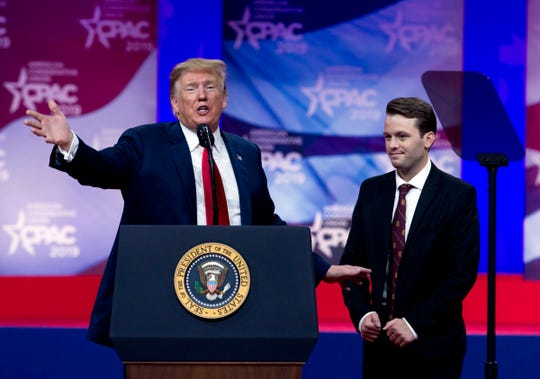 President Donald Trump invites to the podium, Hayden Williams, a field representative of the Leadership Institute, who was assaulted at Berkeley campus, at the Conservative Political Action Conference, CPAC 2019, in Oxon Hill, Md.