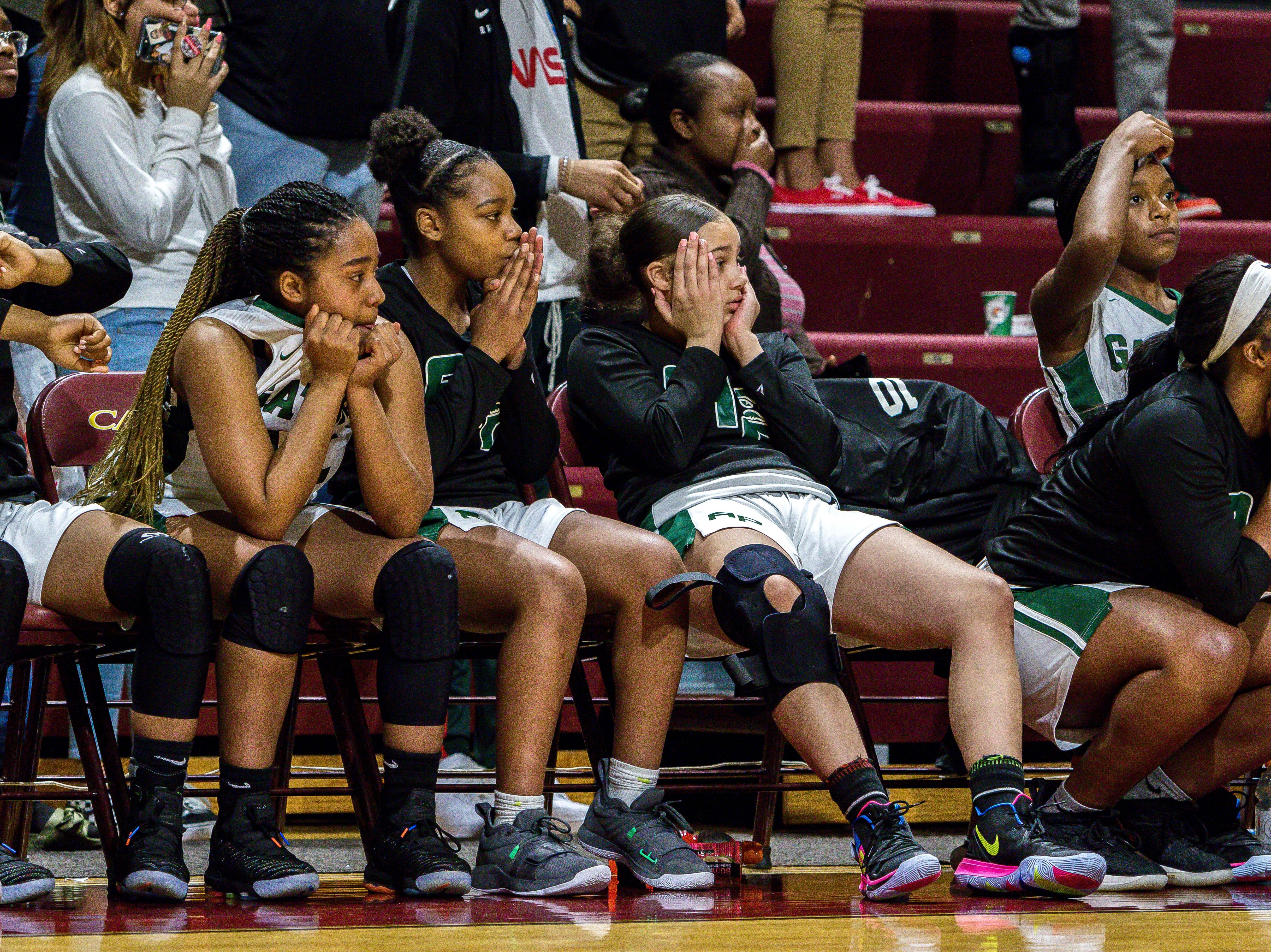 Ypsilanti Arbor Prep players react to their 37-33 overtime loss to Pewamo-Westphalia on Thursday, Mar. 21, 2019 in the MHSAA Div. 3 girls basketball semifinals at Calvin College in Grand Rapids, Michigan.