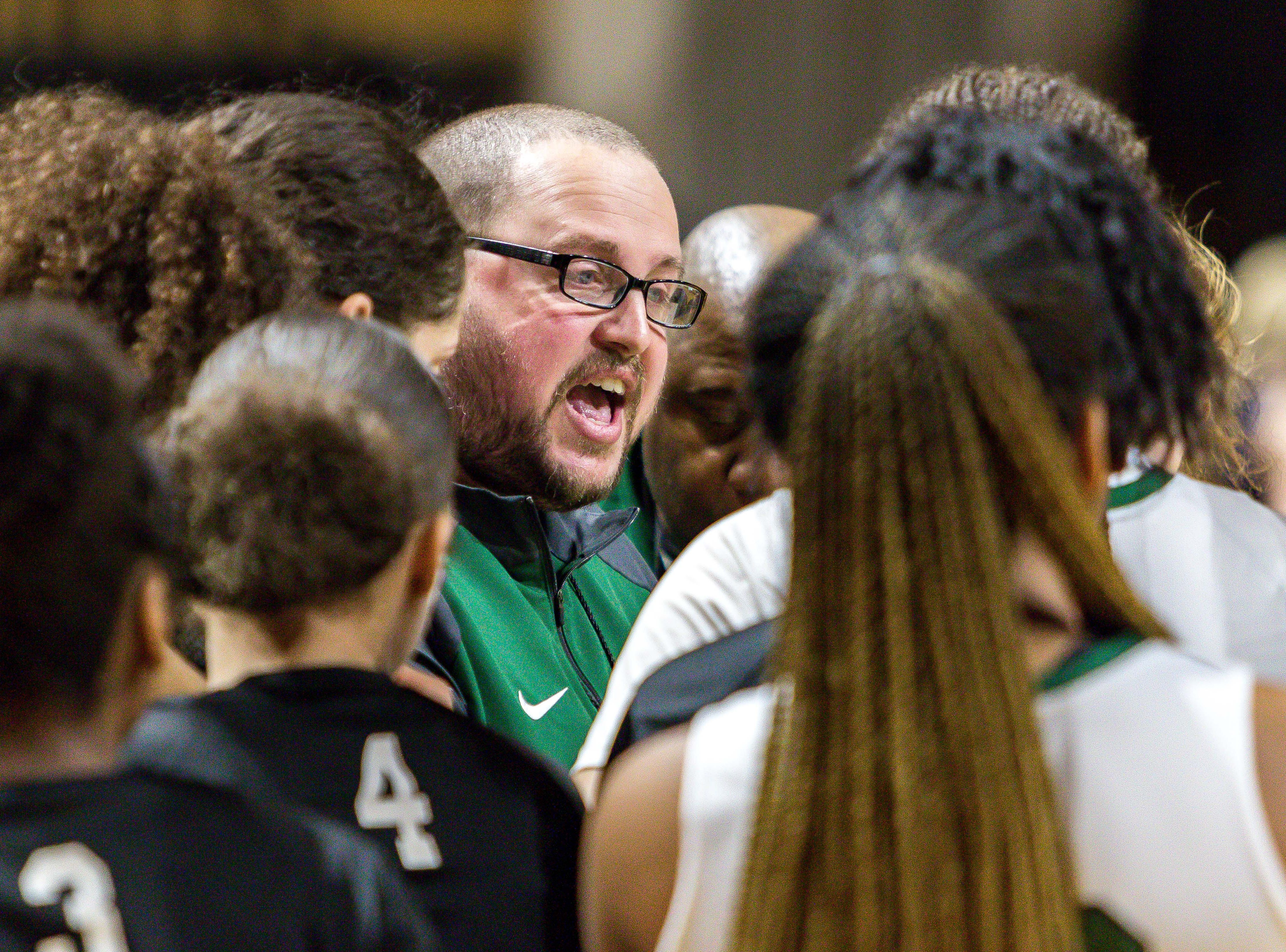 Ypsilanti Arbor Prep coach Scott Stine huddles his team late in the second half.