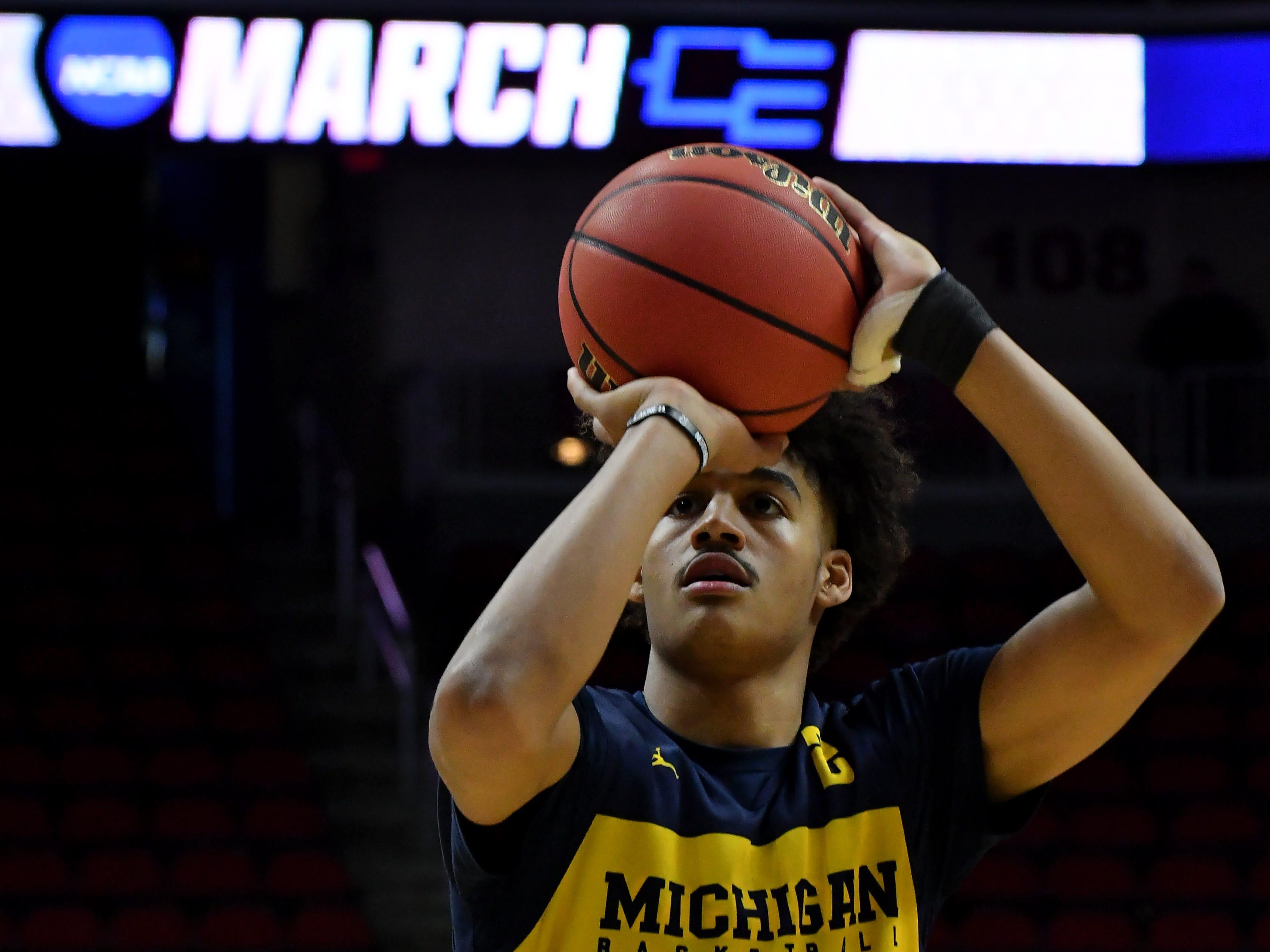 Michigan guard Jordan Poole shoots free throws at Michigan practice.