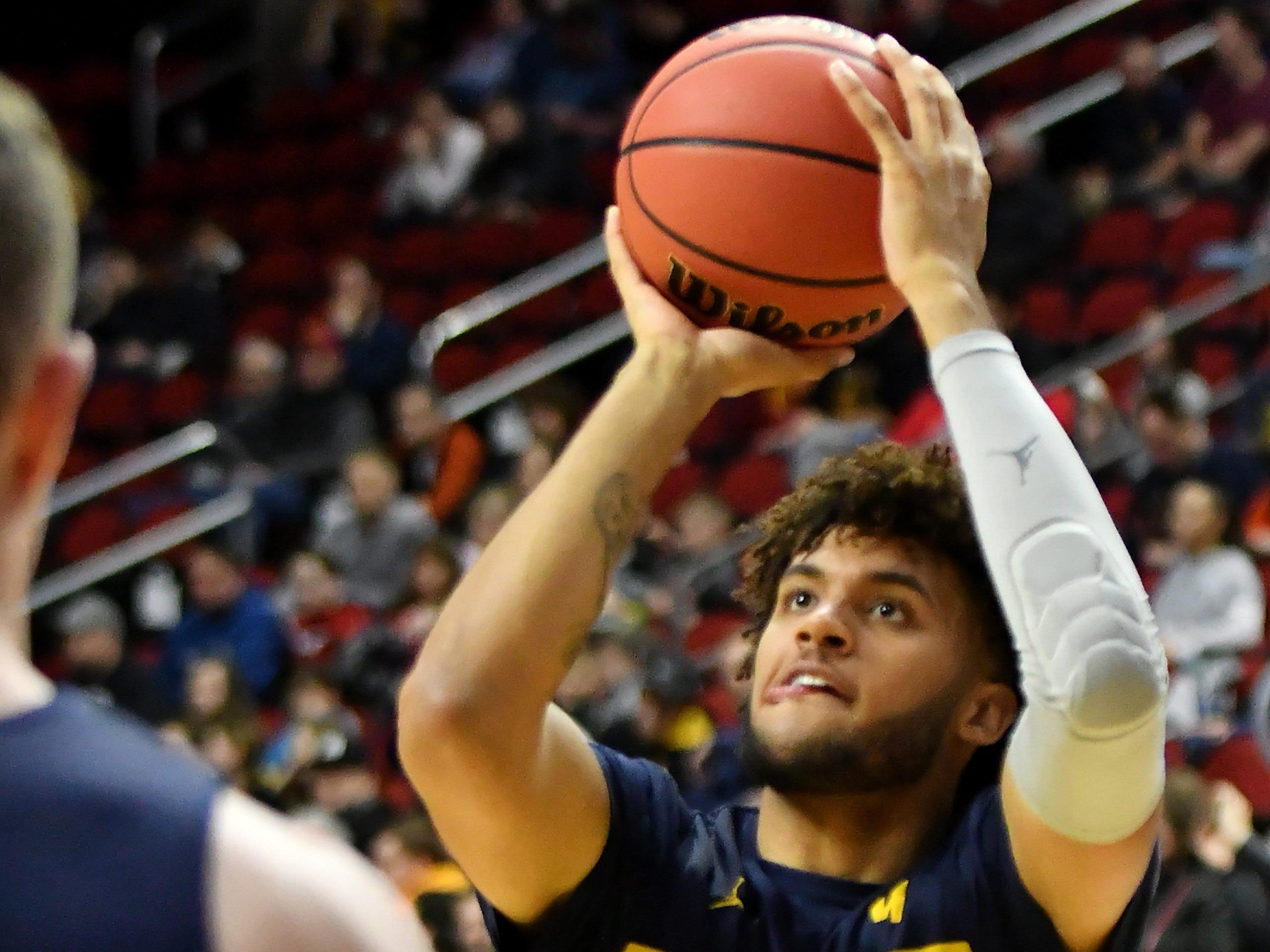 Michigan forward Isaiah Livers takes a shot at Michigan practice.