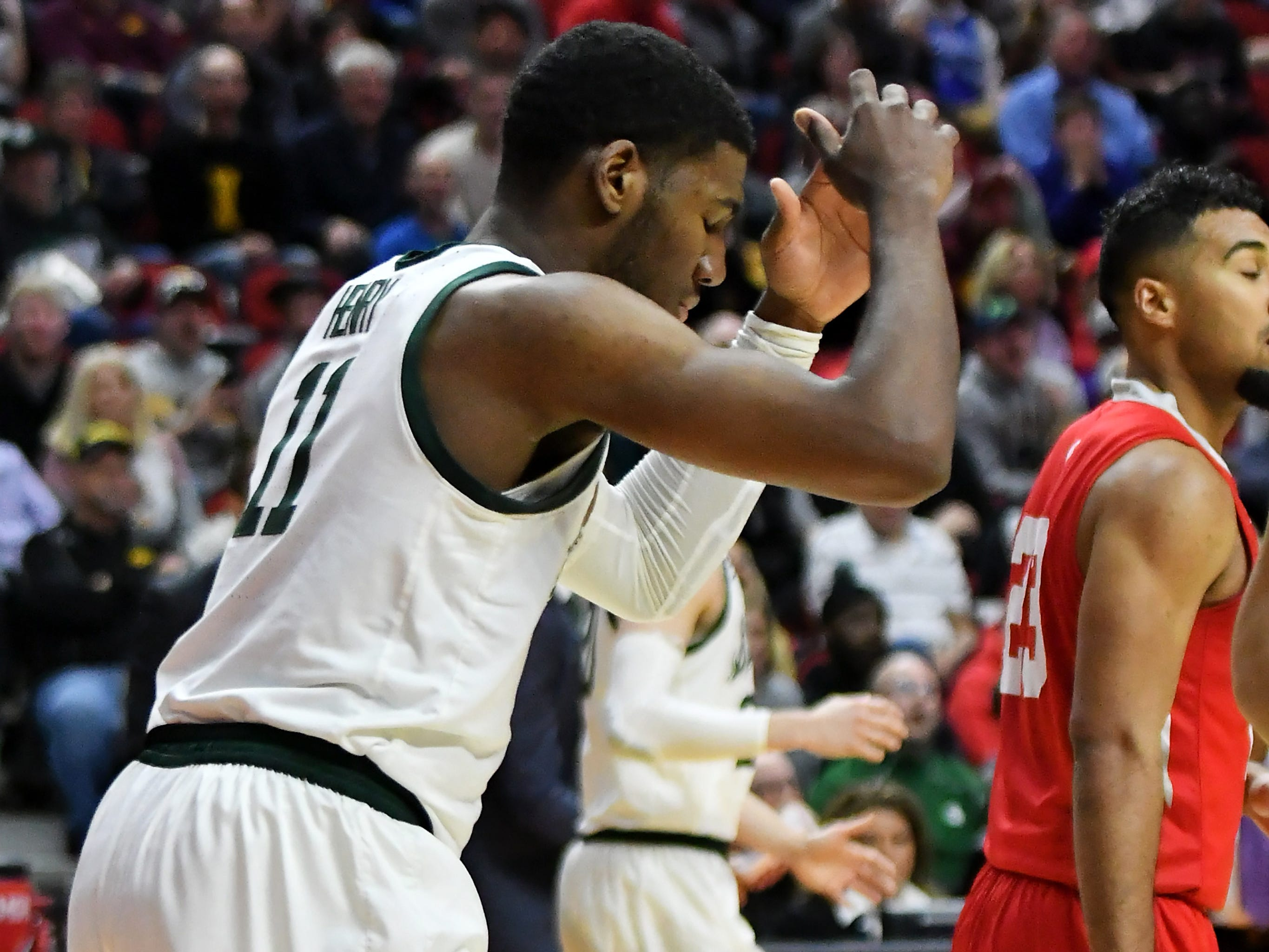 Michigan State forward Aaron Henry (11) reacts after an attempted dunk in the second half.
