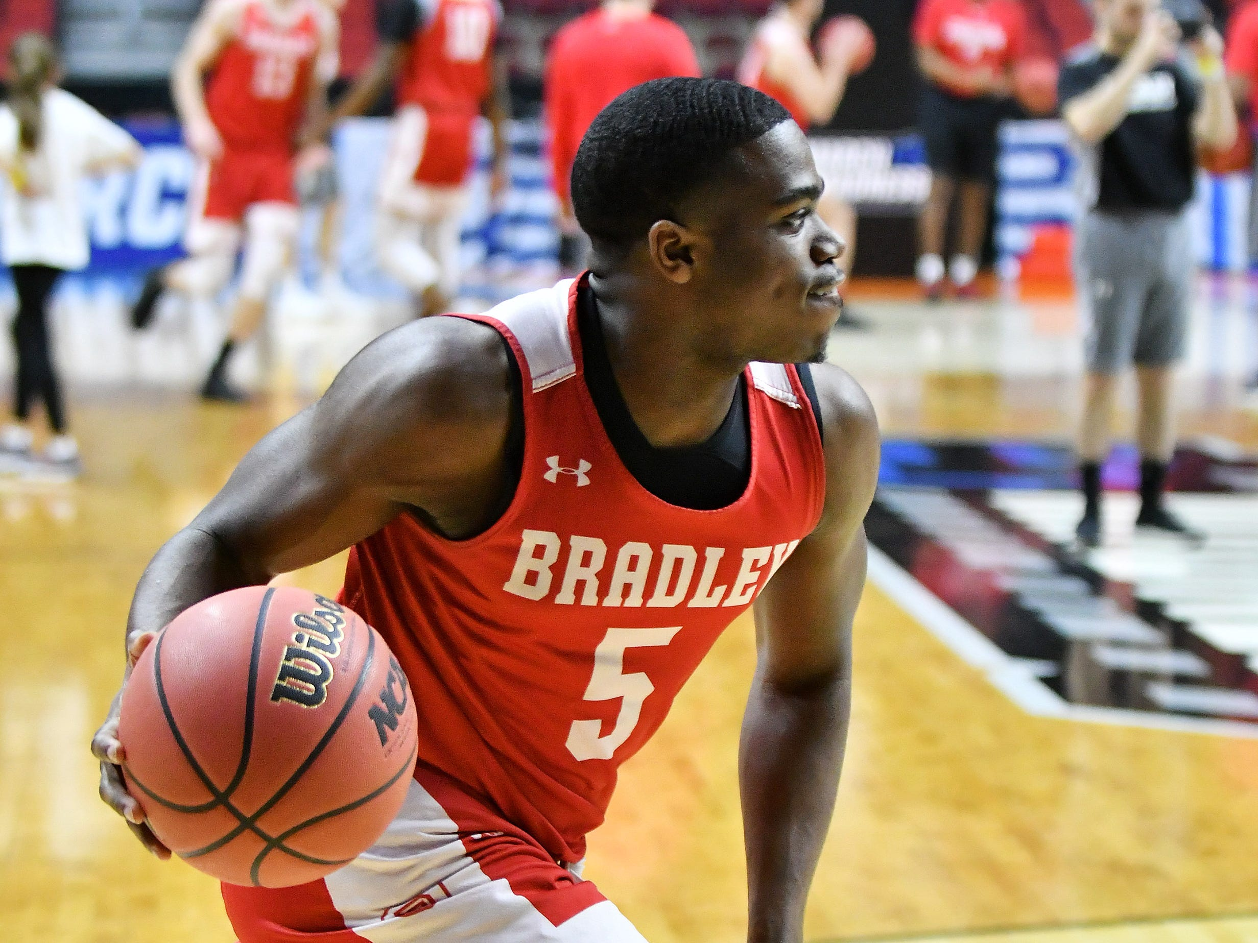 Bradley guard Darrell Brown runs a drill at practice.