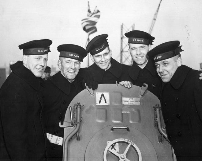 This Feb. 14, 1942 photo provided by the U.S. National Archives shows the five Sullivan brothers on board USS Juneau (CL-52) at the time of her commissioning ceremonies at the New York Navy Yard. The brothers who were all killed in the World War II sinking of the USS Juneau on Nov. 13, 1942. From left to right: Joseph, Francis, Albert, Madison and George Sullivan. Wreckage from the USS Juneau, a Navy ship sunk by the Japanese 76 years ago, has been found in the South Pacific.