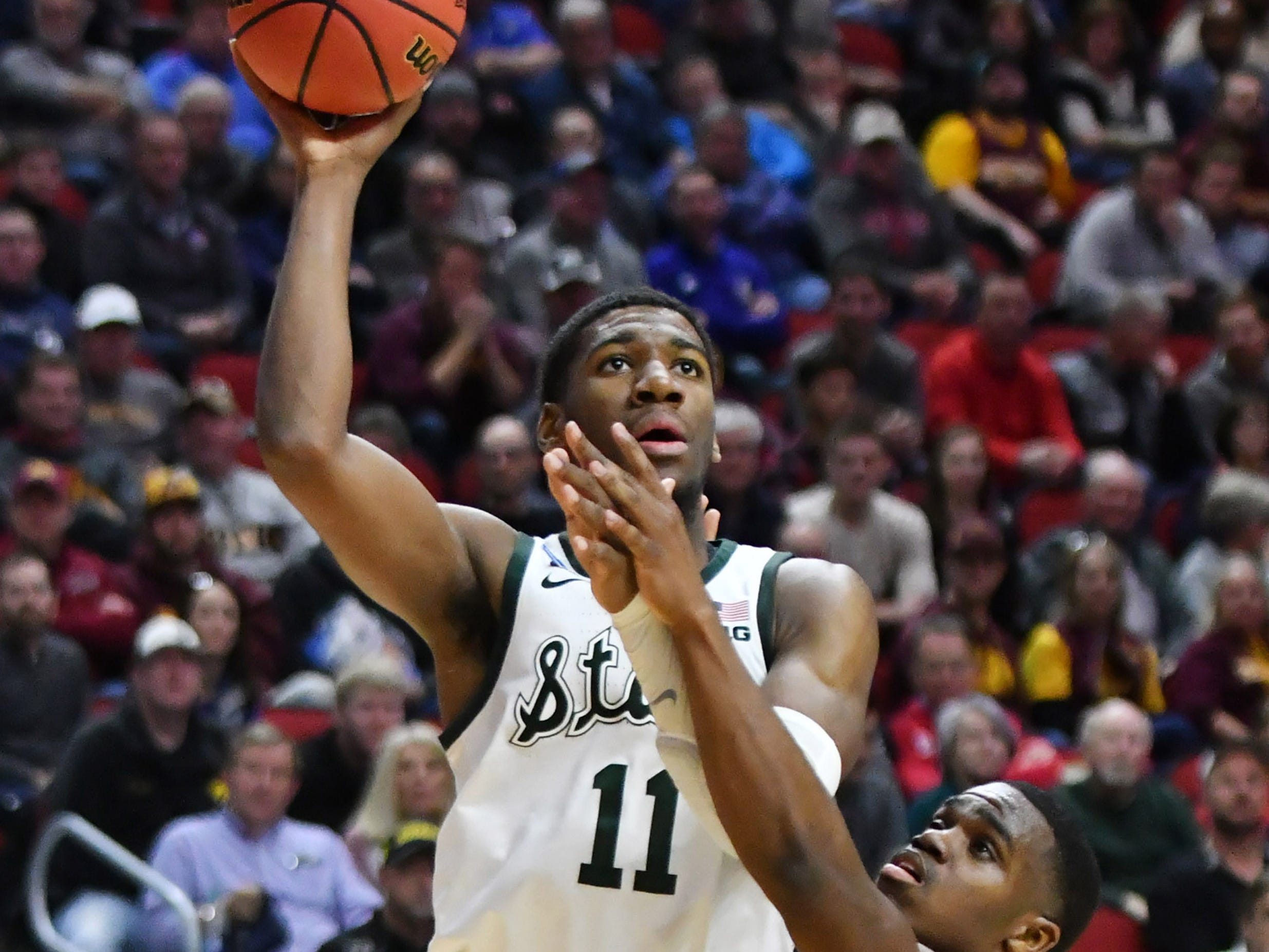 Bradley guard Darrell Brown (5) defends a shot by Michigan State forward Aaron Henry (11) in the second half.