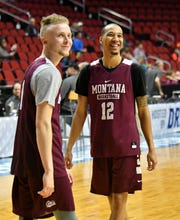 Montana guard Timmy Falls smiles with teammate Kendal Manuel at Wednesday's practice.