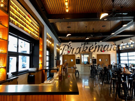 The Brakeman beer hall and Penny Red's fried chicken opens Monday.