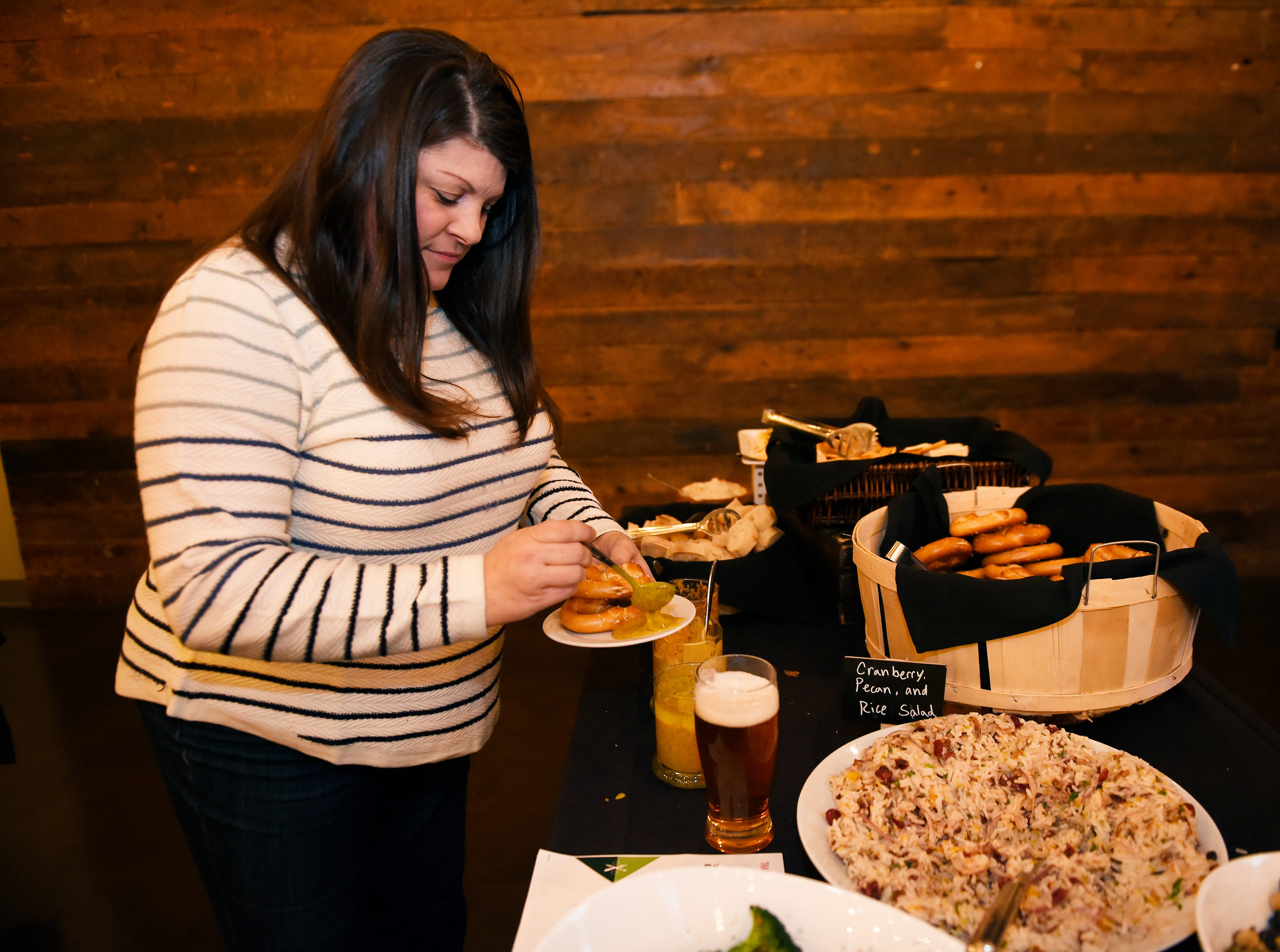 Christine King, 44, of Fenton, Mi, makes a plate of food before the start of the event.