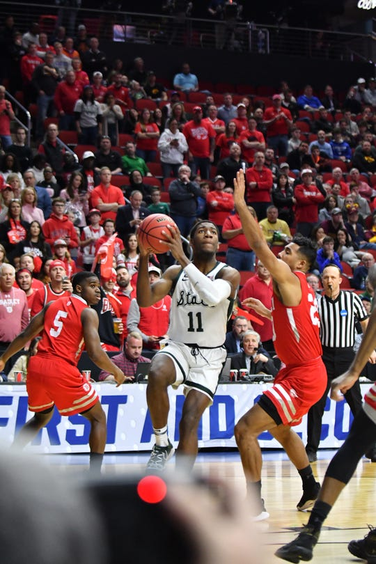 Michigan State freshman Aaron Henry drives to the basket in the first half Thursday against Bradley in the first round of the NCAA Tournament.