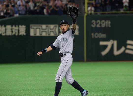 Mariners right fielder Ichiro Suzuki waves to spectators while leaving the field for defensive substitution in the eighth inning Thursday night in Tokyo. He was expected to announce his retirement after the game.