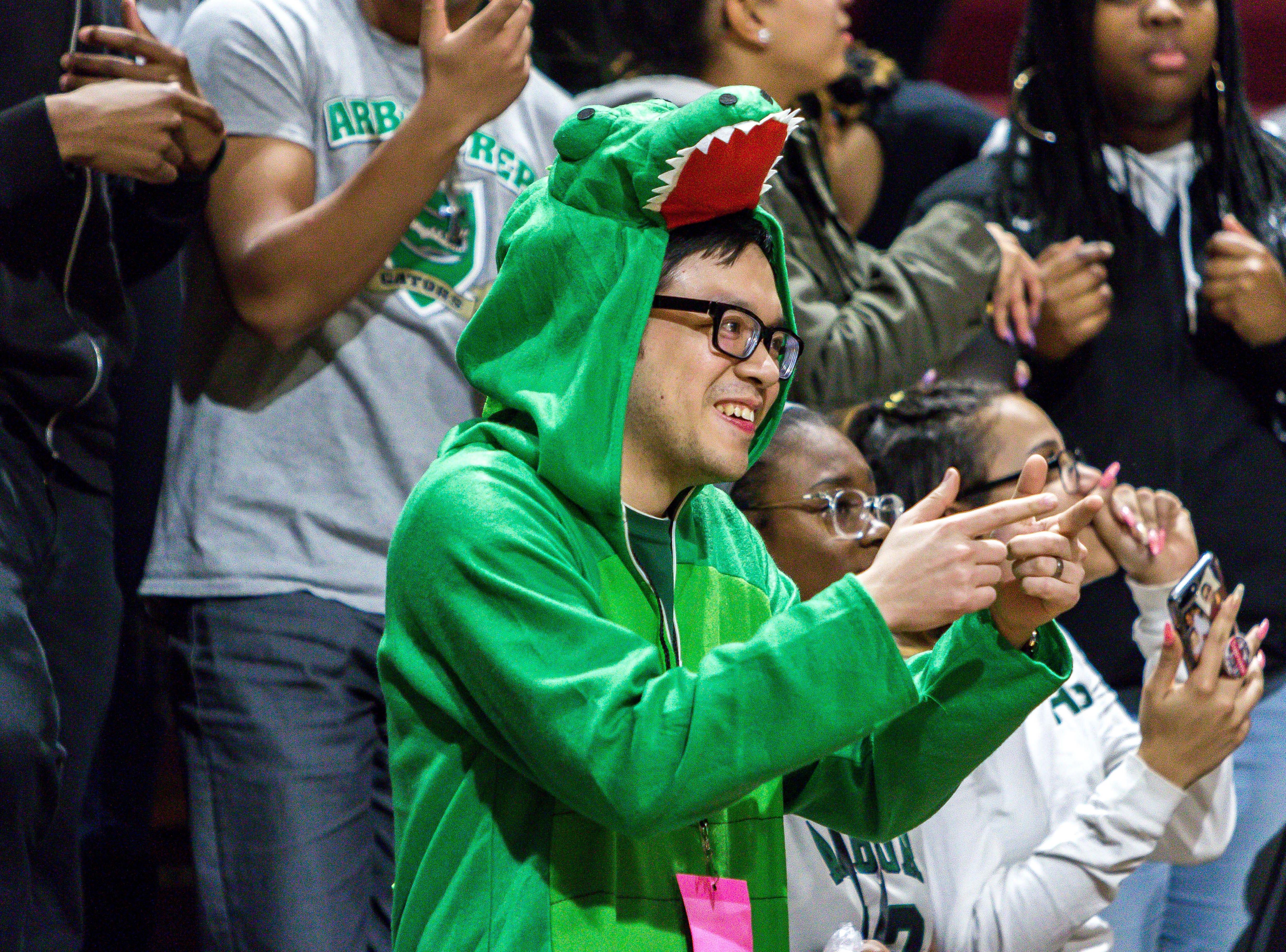 Ypsilanti Arbor Prep's Gator's mascot reacts late in the fourth quarter.