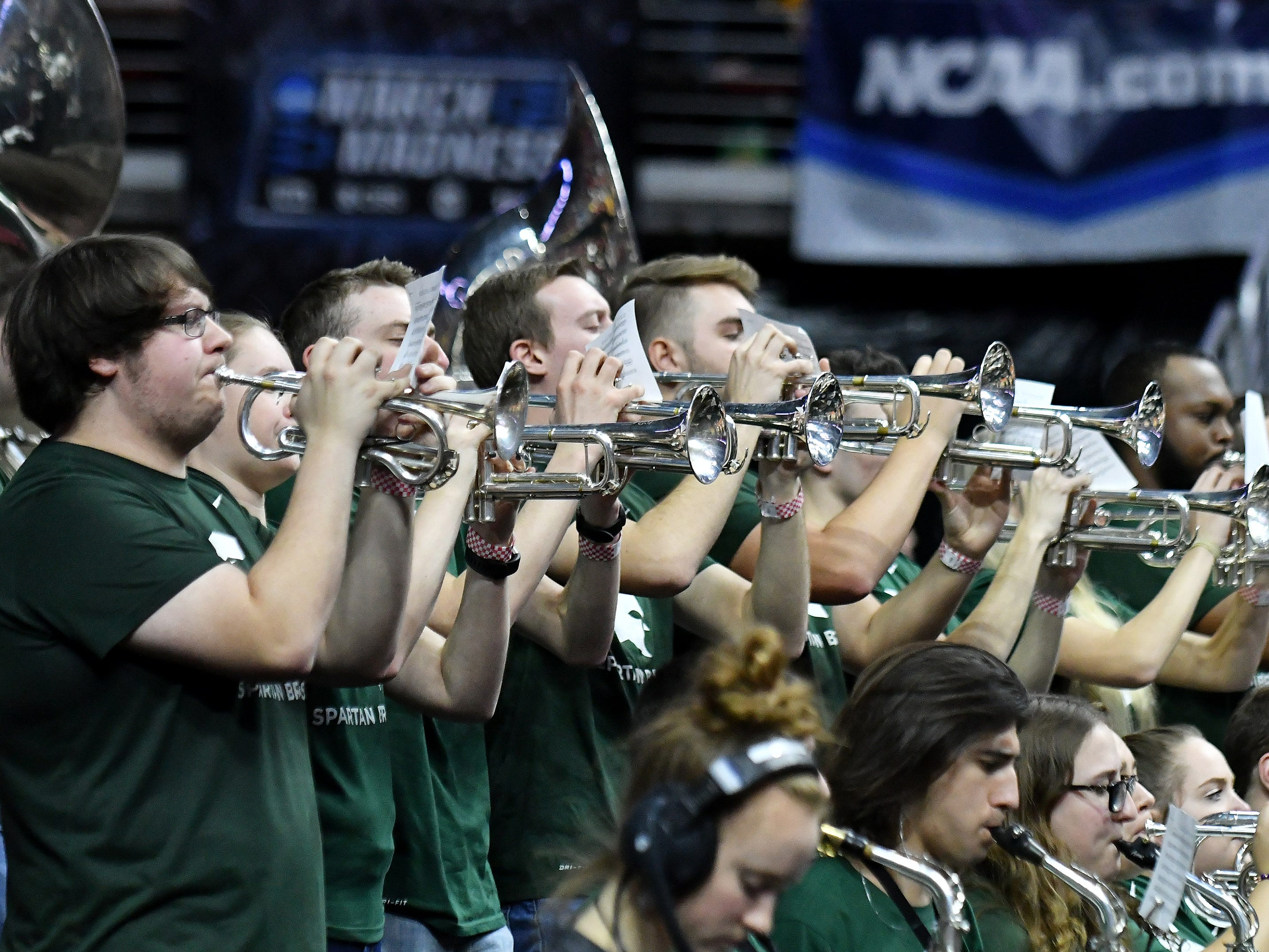 The Michigan State band plays during a time out in the second half.